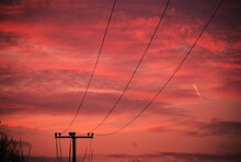 Low Angle View Silhouette Electricity Pylon Against Sky During Sunset