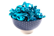 A Bowl Of Blue Wrapped Candy On A White Background