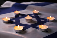 Burning Candles On Flag Of Israel. Holocaust Memory Day