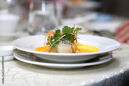 Fototapeta Close-up Of Fish With Coriander Served In Plate On Table obraz