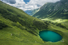 Aerial View Of Little Lake In The Mountains Of Caucasus Nature Reserve, Russia