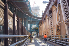 Workers And Joggers Using Pedestrian Walkway On Gigantic Bridge From New York City To Long Island City