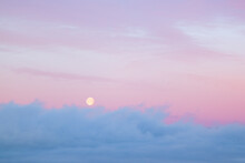 Full Moon Sets Over Morning Fog At Dawn