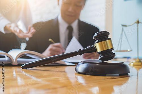 Obraz na plátně Lawyers Doing Paperwork At Desk In Courthouse