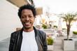 Leinwandbild Motiv Portrait of afro man standing outdoors.