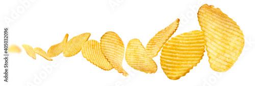 Fotografia Fluted potato chips levitate on a white background