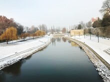 Scenic View Of Frozen Canal Against Sky During Winter