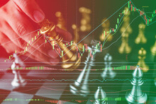 Digital Composite Image Of Cropped Hand Holding Chess Piece By Graph