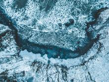 Aerial View Of Sea Waves Hitting Rock Beach