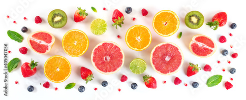 Fresh fruit panorama. Citrus fruits with blueberries and mint, overhead flat lay shot on a white background