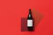 Leinwandbild Motiv Bottle of wine with blank label on color background
