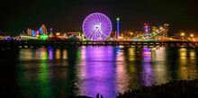 Ferris Wheel By Body Of Water During Night Time
