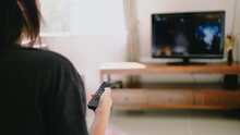 Watching Smart  TV And Using Remote Controller Tv Hand Holding Television  Audio Remote Control  With The Remote Control Television.