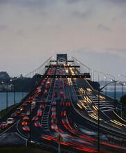 Traffic Flowing Both Ways On Auckland Harbour Bridge At Dusk
