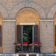 Rome Italy, Vintage Building Balcony Arched Window Decorated With Colorful Flowers