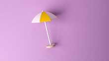 Multicolored Beach Umbrella On Pink Background