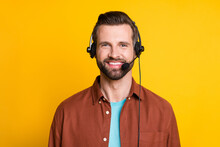 Photo Portrait Of Call Center Employee Smiling In Earphones With Microphone Isolated On Vivid Yellow Color Background