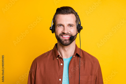 Canvastavla Photo portrait of call center employee smiling in earphones with microphone isol