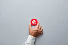 Businessman Hand Holding A Red Badge With Copyright Symbol. Property Rights And Brand Patent Protection In Business