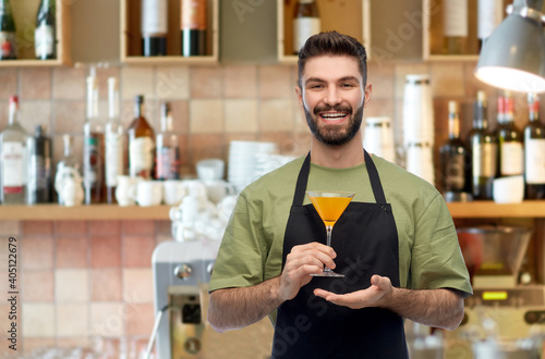 Fototapeta alcohol drinks, people and profession concept - happy smiling barman in black ap