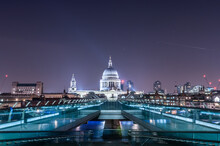 London Millenium Bridge At Night With Illuminated Building Of St Pauls Cathedral At The Background