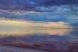 Dark storm clouds over a salt lake before a rain