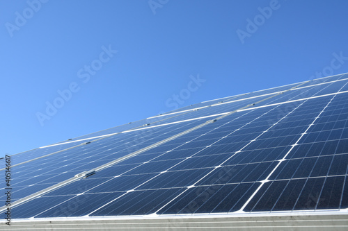 Obraz Solar panels against blue sky background.Against The Deep Blue Sky in suny weather - fototapety do salonu