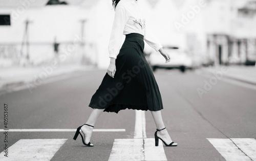 Low Section Of Woman Walking On Zebra Crossing In City Fototapet