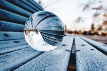 Close-up Of Crystal Ball On Frozen Bench