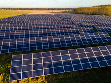 View To Solar Panels On Field At Sunny Autumn Morning From Above
