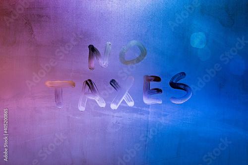 Billede på lærred words no taxes handwritten on night wet window glass surface