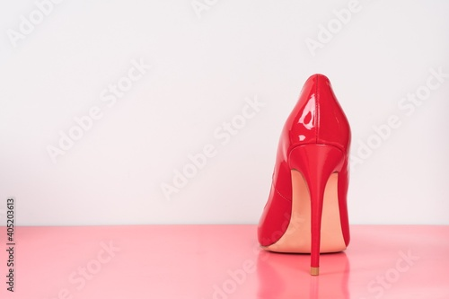 Close-up Of Red High Heels Against White Background On Table Fototapeta