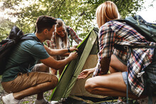 Young Group Of Hikers  Assembling Tent In Camp Area.