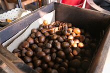 Roasted Chestnuts In Wooden Bucket