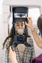 Woman In Dental X-Ray Machine