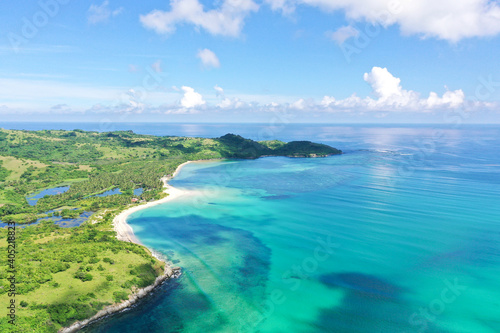 A tropical island with a turquoise lagoon and a sandbank. Caramoan Islands, Philippines.