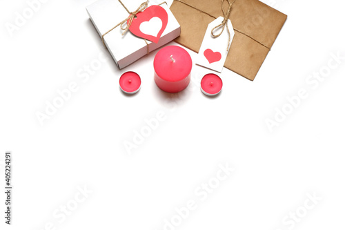 Love, Valentine's, women's day, relations, romantic composition from white gift box and gift wrapped in craft paper, tied with twine with bows and labels with red hearts and candles white background