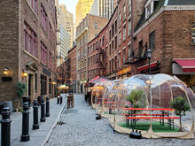 New York City 2020: Restaurants And Bars Enforce Social Distance Safety With Outdoor Dining Bubbles On Stone Street In Manhattan During The Coronavirus Pandemic