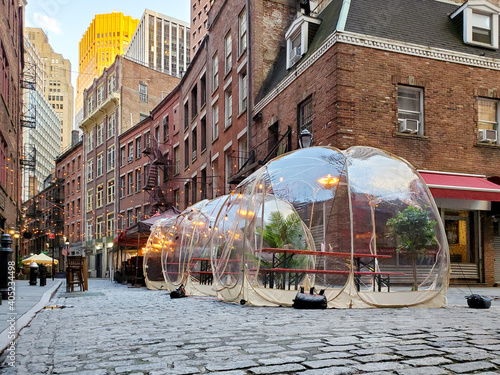 Outdoor dining tables in bubbles along Stone Street during the coronavirus pandemic in downtown Manhattan, New York City