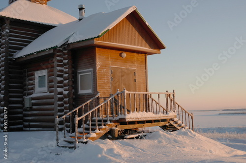 Fotomural fragment of a chapel on a hillside on a frosty day