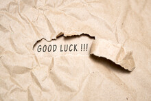 Uncovering A Good Luck. There Is A Hole In The Craft Paper, The Word Good Luck