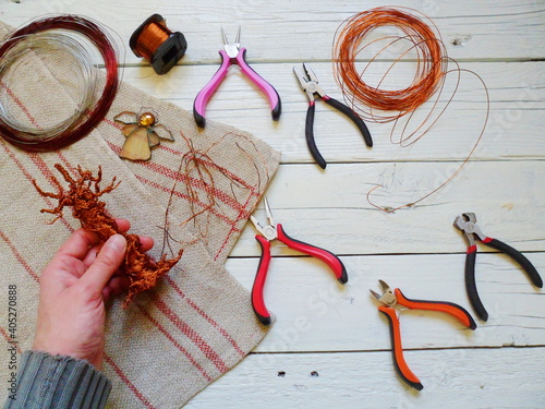 Slika na platnu High Angle View Of Hand Holding Copper By Tools