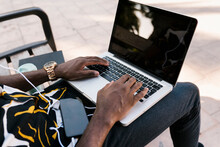 Hands Of Male Entrepreneur Typing On Laptop