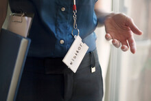 Businesswoman Wearing Visitor Lanyard Standing At Office
