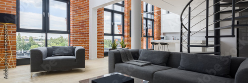 Living room in loft with big windows, panorama