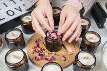 Decorating Handmade Soy Candles With Dried Flowers. Amber And Opaque Container. Cruelty-free Vegan Product, Handmade With Love