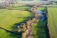 Aerial Photo Of The British Country Side Fields In The Winter Time Showing A River That Has Burst It's Bank To Overspill Water On The Fields, Taken In The Town Of Wetherby In Yorkshire In The UK