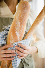 Close Up Of Woman's Hands Holding Baguette