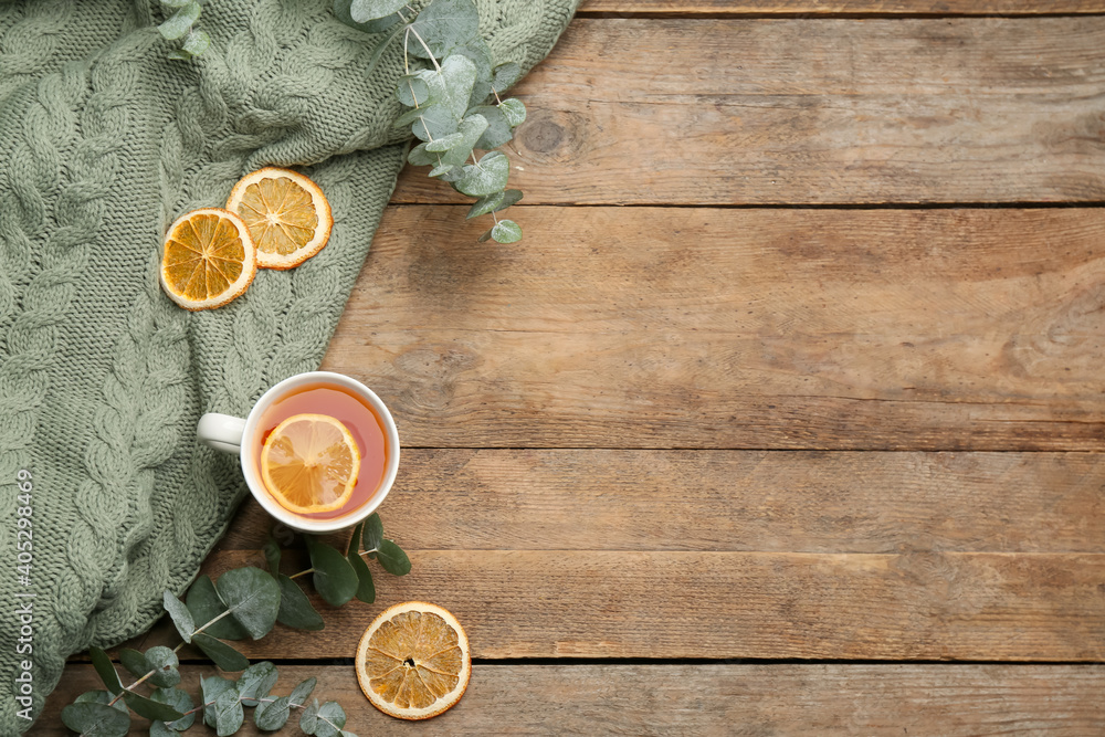Fototapeta Flat lay composition with tea and warm plaid on wooden table, space for text