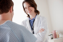 Smiling Doctor Talking With Patient